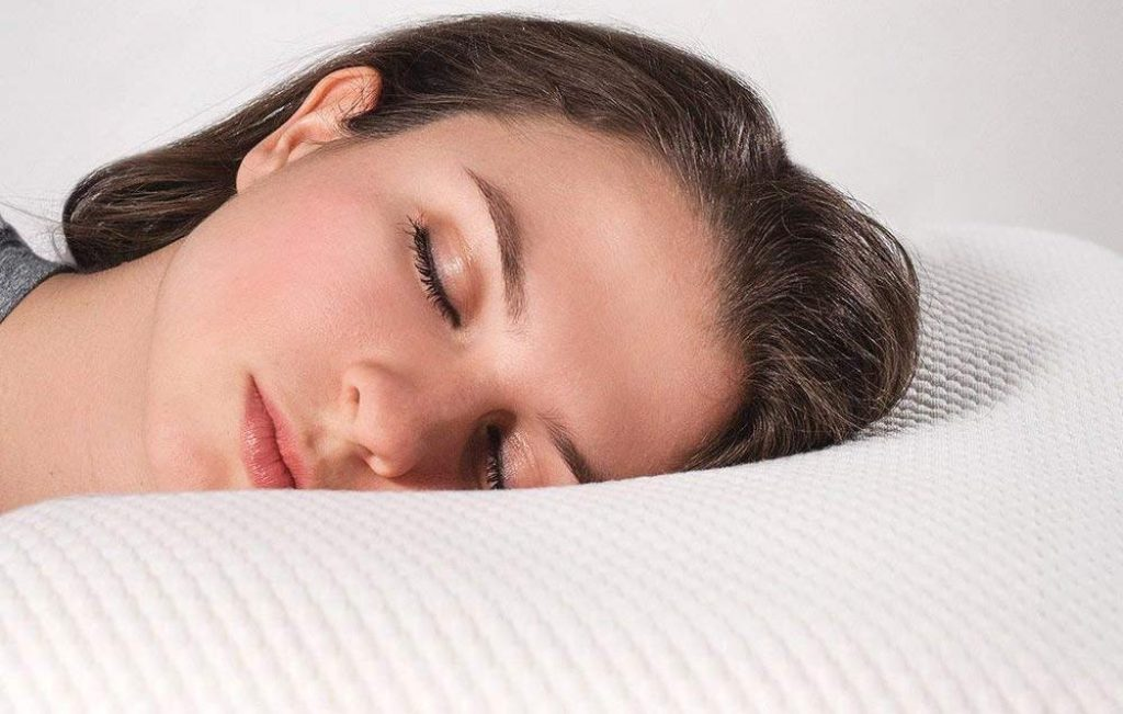 A woman is sleeping on a pillow