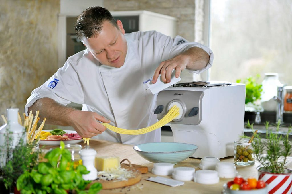 The man is making pasta